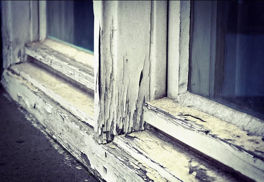 Old damaged wood window